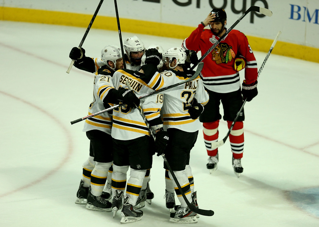. CHICAGO, IL - JUNE 15:  Chris Kelly #23 of the Boston Bruins celebrates with teammate Daniel Paille #20 after scoring a goal in the second period to tie the game up against Corey Crawford #50 of the Chicago Blackhawks in Game Two of the NHL 2013 Stanley Cup Final at United Center on June 15, 2013 in Chicago, Illinois.  (Photo by Jonathan Daniel/Getty Images)