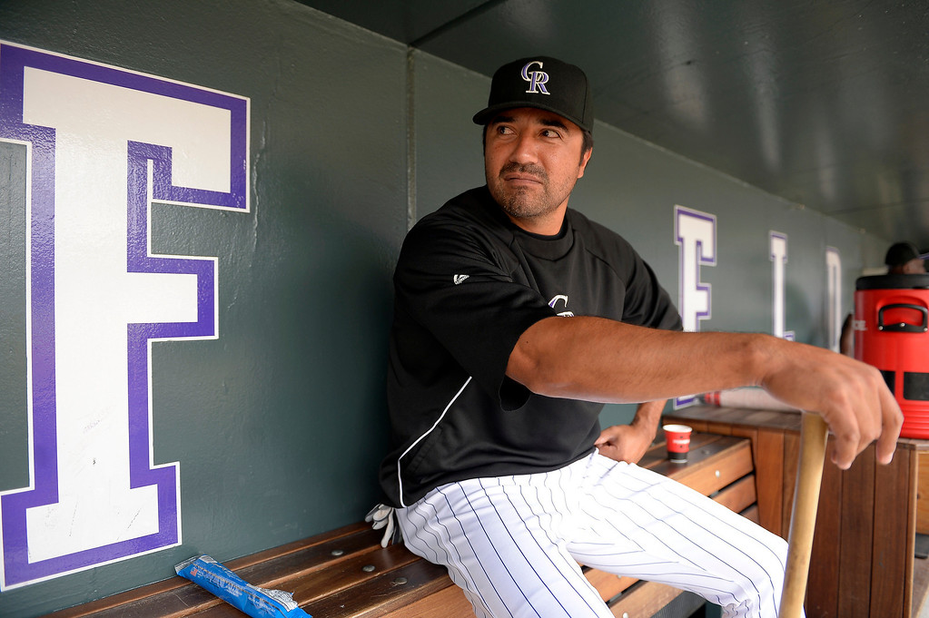 . Colorado Rockies Vinny Castilla sits in the dugout during an open workout session July 18, 2013 at Coors Field. This is the teams first time back since the All Star break. (Photo By John Leyba/The Denver Post)