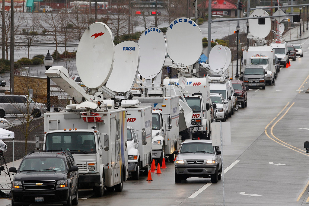 . Television satellite trucks line the roadway by Clackamas Town Center shopping mall in Portland, Oregon, December 12, 2012. The masked gunman who opened fire in a crowded Oregon shopping mall, killing two people and wounding a third before taking his own life, appeared to have acted in a blind rampage with no known motive, authorities said on Wednesday.  REUTERS/Steve Dipaola