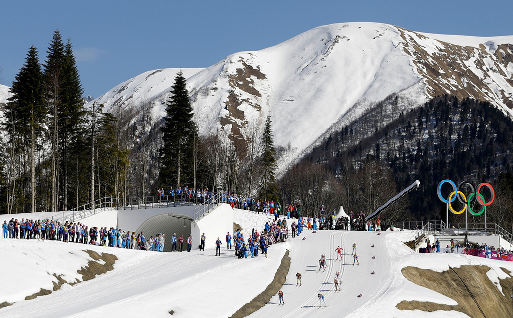 . Competitors ski past the Olympic rings during the women\'s 4x5K cross-country relay at the 2014 Winter Olympics, Saturday, Feb. 15, 2014, in Krasnaya Polyana, Russia. (AP Photo/Kirsty Wigglesworth)