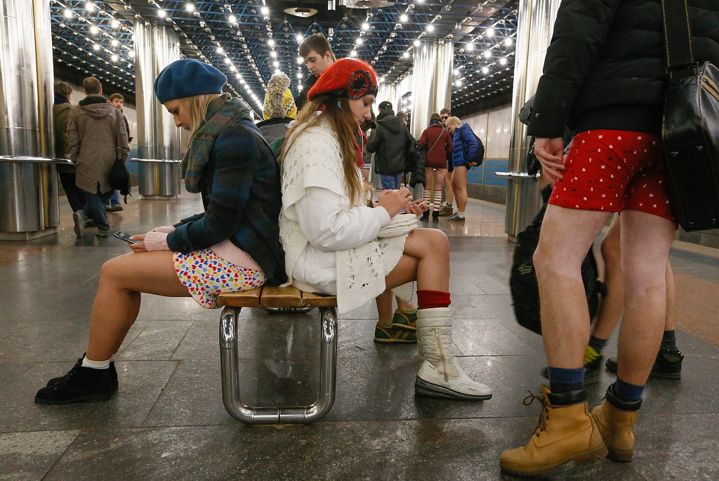 . Young Ukrainians wearing no pants participate in the first \'No Pants Subway Ride\' in Kiev, Ukraine, 12 January 2014. No Pants Subway Ride is an annual global event started in New York, USA in 2002. This is the first time that the event is organized in Ukraine.  EPA/SERGEY DOLZHENKO