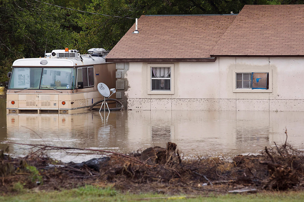 . This photo shows a home on Bluff Springs Road submerged in Austin, Texas, on Thursday, Oct. 31, 2013. Heavy overnight rains brought flooding to the area. (AP Photo/Austin American-Statesman, Ralph Barrera)