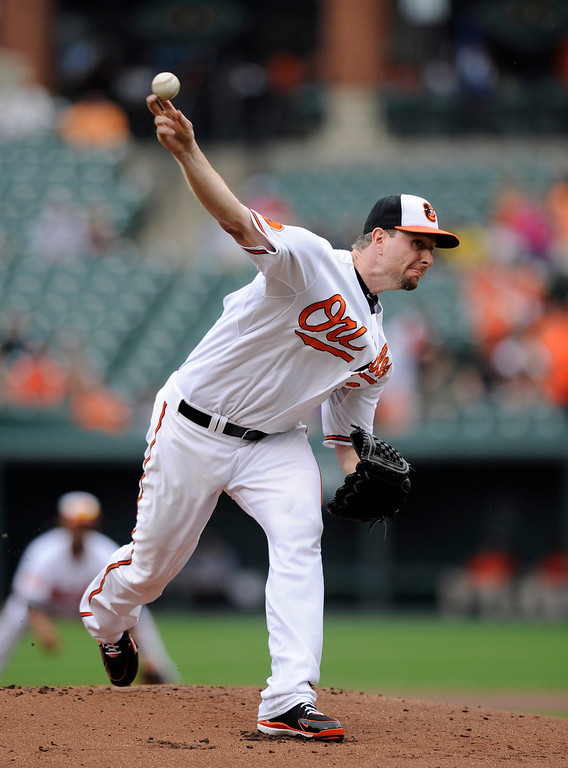 . Baltimore Orioles starting pitcher Scott Feldman delivers against the Colorado Rockies during the first inning of a baseball game on Sunday, Aug. 18, 2013, in Baltimore. (AP Photo/Nick Wass)