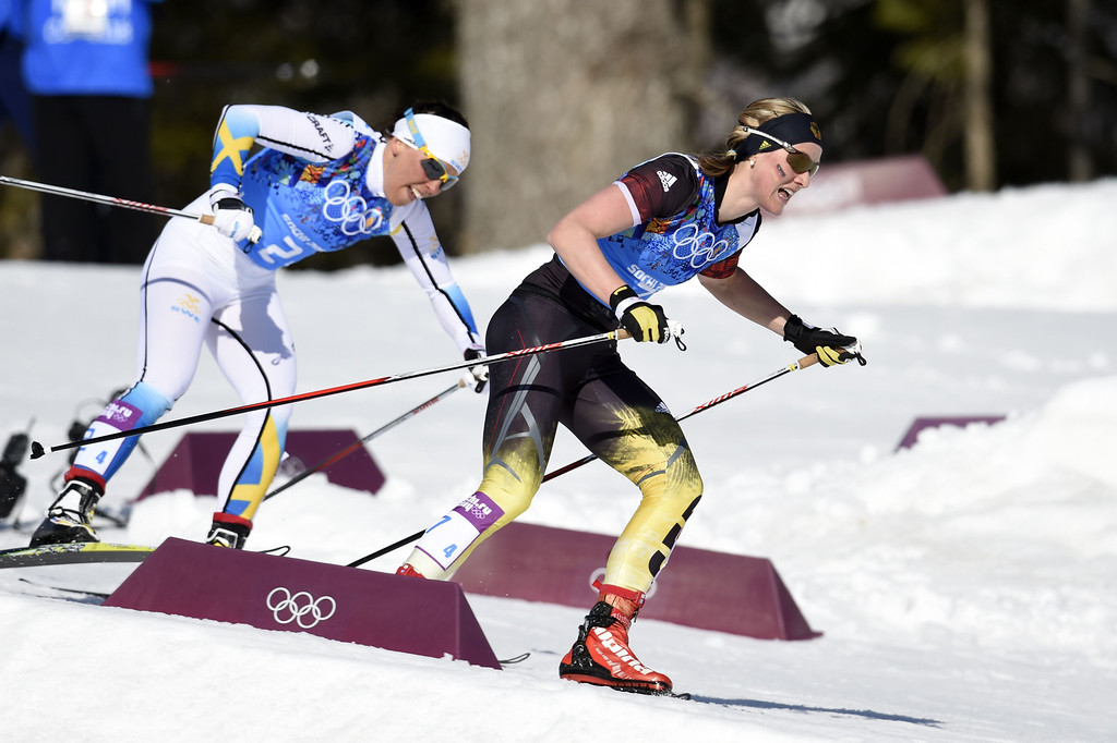 . Sweden\'s Charlotte Kalla (R) and Germany\'s Denise Herrmann compete in the Women\'s Cross-Country Skiing 4x5km Relay at the Laura Cross-Country Ski and Biathlon Center during the Sochi Winter Olympics on February 15, 2014, in Rosa Khutor, near Sochi.     ODD ANDERSEN/AFP/Getty Images