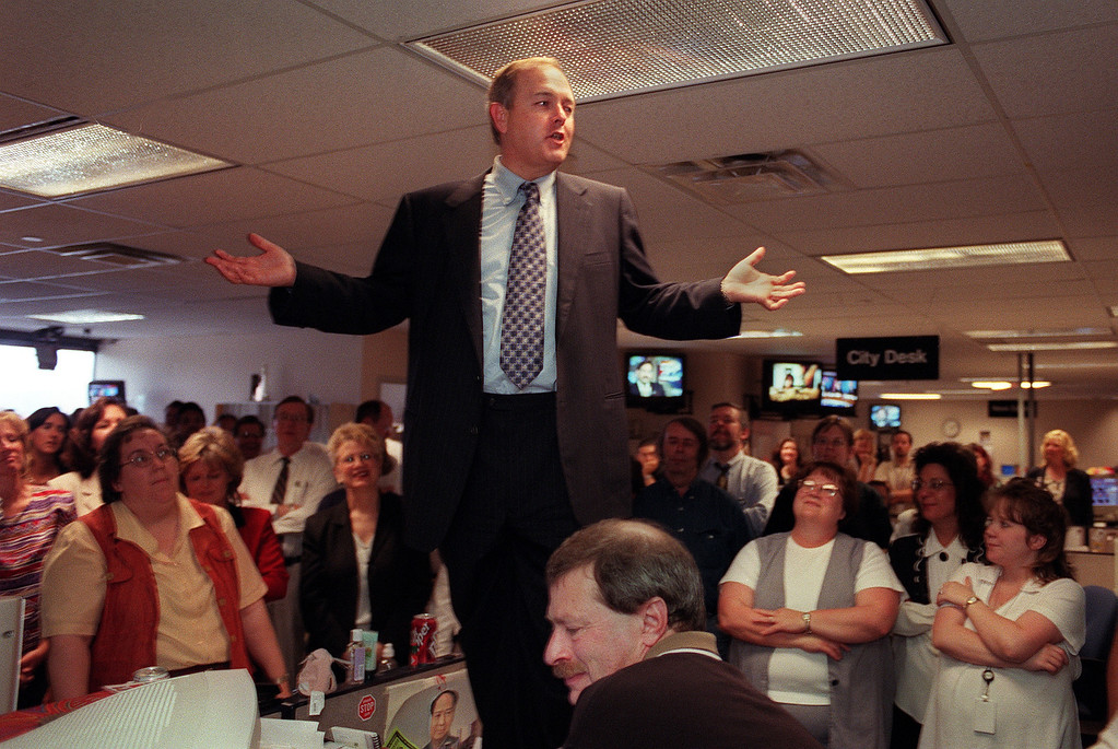 . Dean Singleton, CEO of MediaNews Group Inc., stood on the top of a desk in the second-floor Denver Post newsroom to talk to employees about the joint operating agreement between the two Denver daily newspapers. KARL GEHRING / The Denver Post