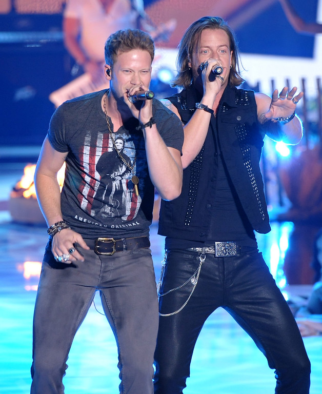 . Brian Kelley, left, and Tyler Hubbard, of Florida Georgia Line, perform at the Teen Choice Awards at the Gibson Amphitheater on Sunday, Aug. 11, 2013, in Los Angeles. (Photo by John Shearer/Invision/AP)