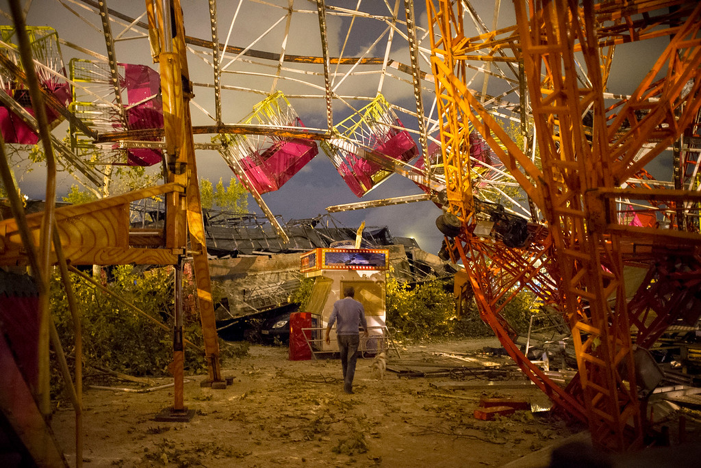 . A man walks under the wreckage of a fair ride after a tornado ripped through a fun fair in Gandia, near Valencia on September 29, 2012.  Ten people, including a young girl and an elderly woman, have died in Spain as a result of floods brought on by downpours, regional officials said. (PEDRO ARMESTRE/AFP/GettyImages)