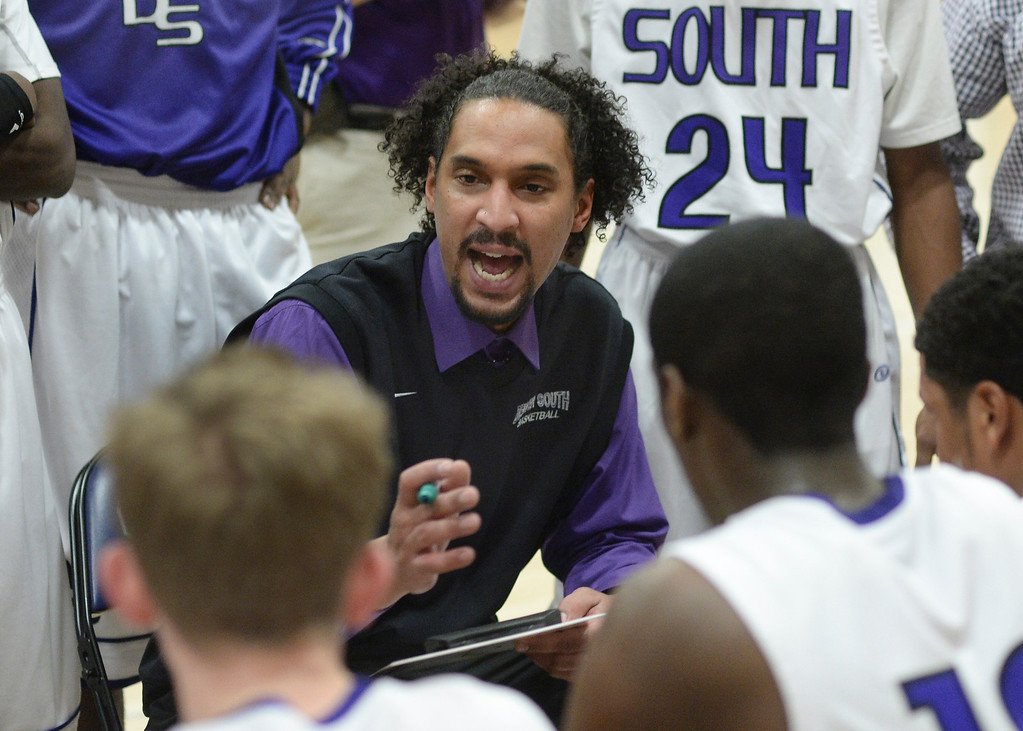 . Denver South coach Malik Fletcher organized the team during a time out.  Photo By Karl Gehring/The Denver Post