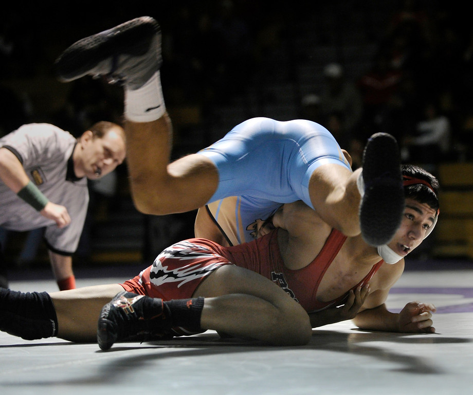 . ARVADA, CO - JANUARY 19: Greeley West High School wrestler Adrian Delacruz, top, tangled with Pomona\'s Josh Rosales, bottom, during the championship bout to decide the 120-weight class. The Arvada West High School wrestling tournament wrapped up Saturday night, January 19, 2013. Karl Gehring/The Denver Post