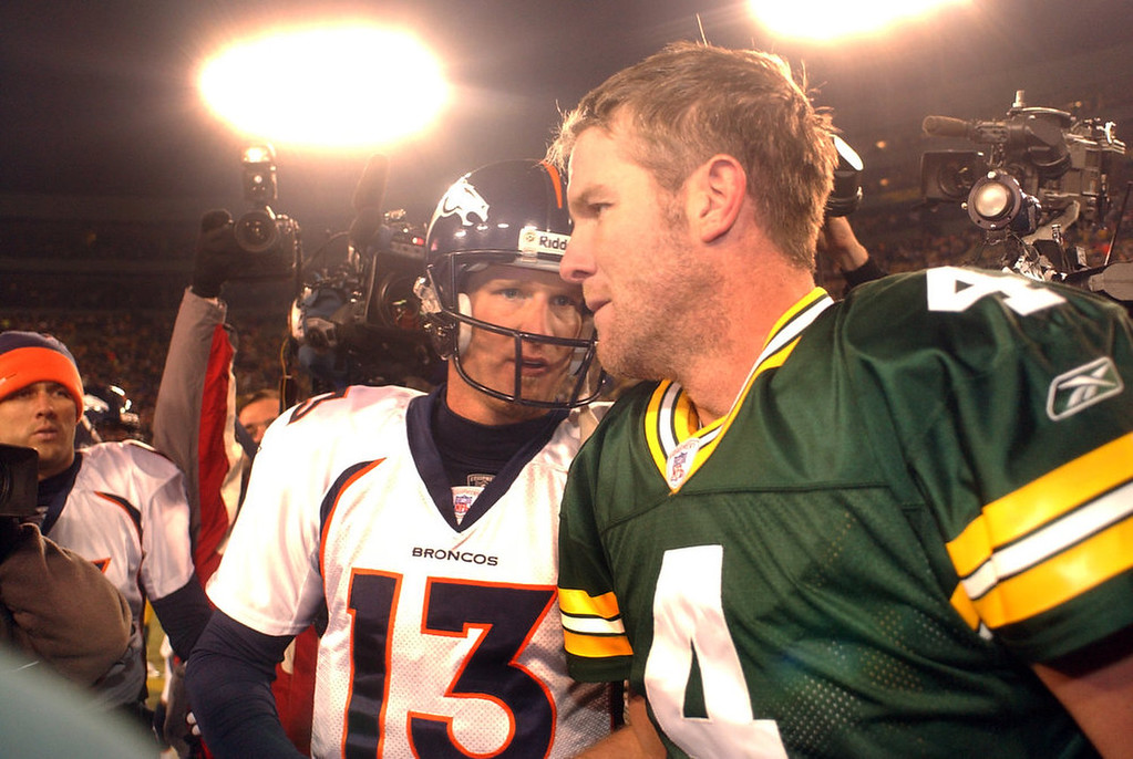 . Denver Bronco backup QB Danny Kanell greets Green Bay Packer QB Brett Farve as Jake Plummer sneaks in from the left after a \'meaningless\' game at Lambeau Field on Sunday Dec. 28th,2003.  The Broncos rested most of their starters including QB Jake Plummer and WR Rod Smith since they had already clinched a playoff spot  and went on to lose their playoff game to the Indianapolis Colts. (THE DENVER POST PHOTO BY HYOUNG CHANG)