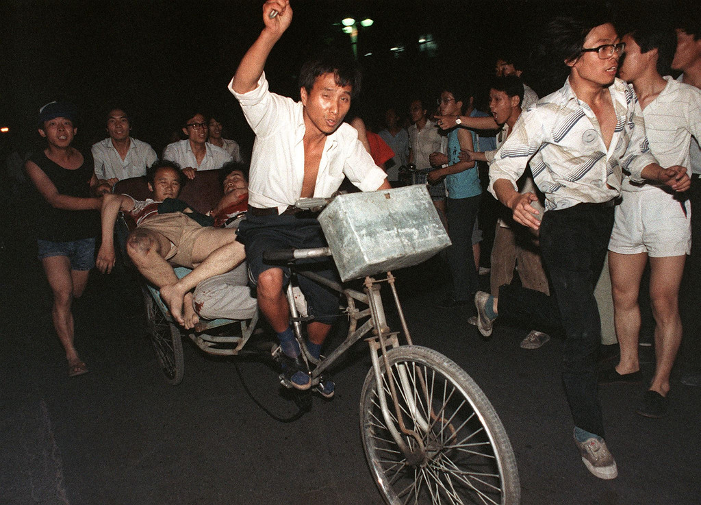 . Two injured during the clash between the army and students 04 June 1989 near Tiananmen Square are carried out by a cart.  ( MANUEL CENETA/AFP/Getty Images)