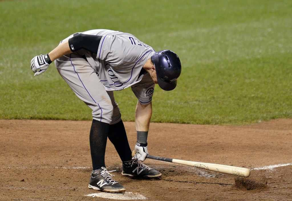 . DJ LeMahieu #9 of the Colorado Rockies slams his bat into the ground after after failing to connect on a suicide squeeze in the tenth inning against the Chicago Cubs on July 29, 2014 at Wrigley Field in Chicago, Illinois.  (Photo by Brian Kersey/Getty Images)