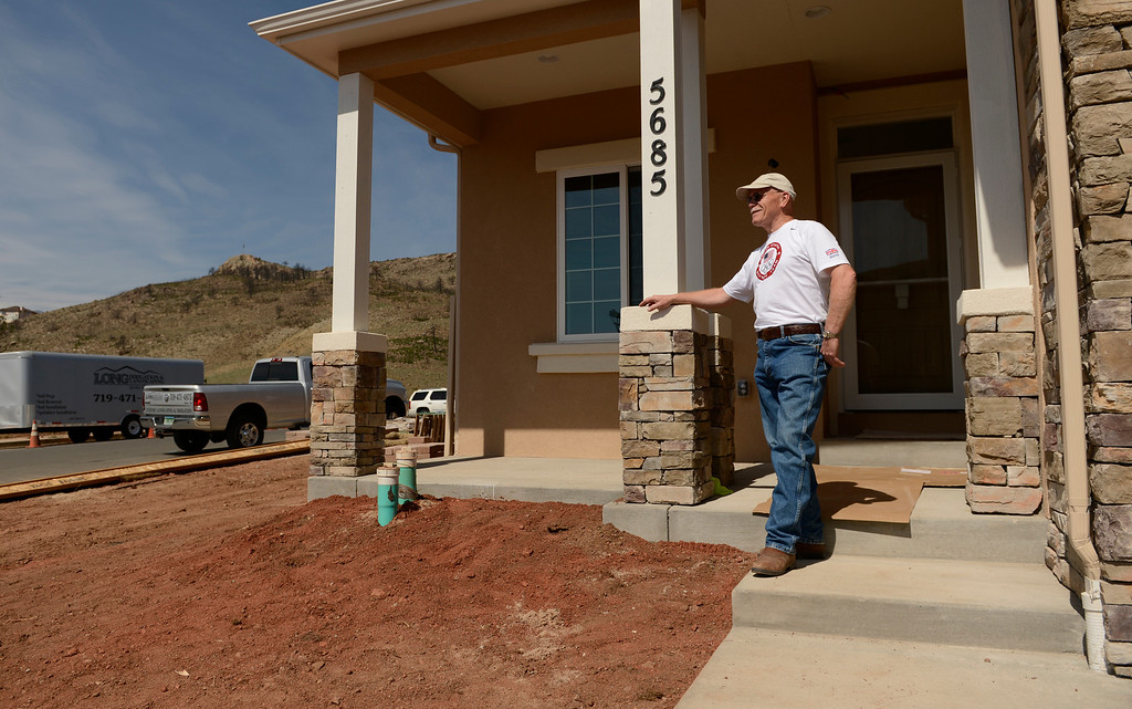 . Home owner Ralph Moreman outside his new home in the Mountain Shadows neighborhood in Colorado Springs, June 20, 2013. (Photo By RJ Sangosti/The Denver Post)