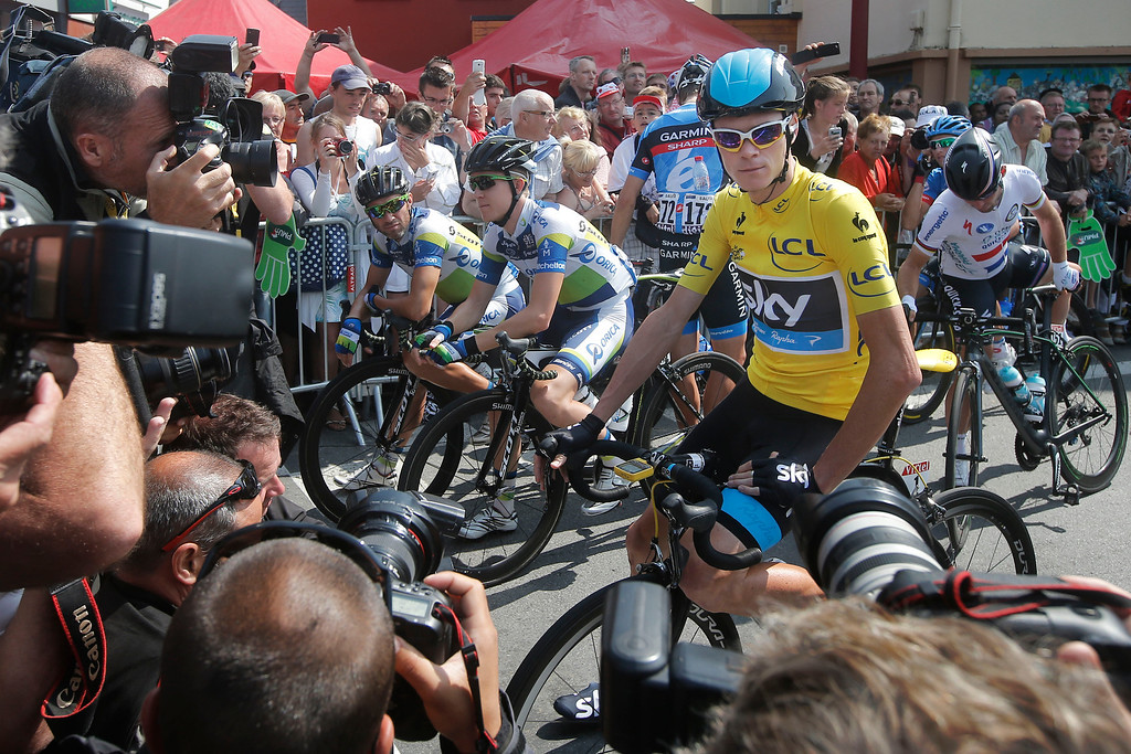 . Photographers take picture of Christopher Froome of Britain, wearing the overall leader\'s yellow jersey, prior to the twelfth stage of the Tour de France cycling race over 218 kilometers (136.2 miles) with start in in Fougeres and finish in Tours, western France, Thursday July 11 2013. (AP Photo/Christophe Ena)