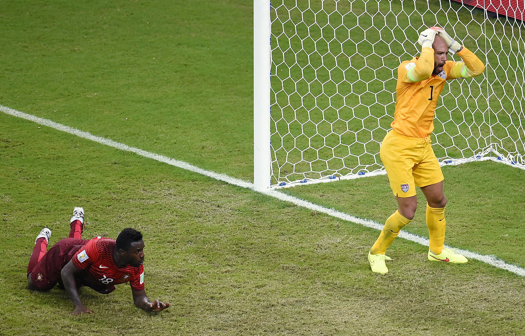 . US goalkeeper Tim Howard (R) reacts after Portugal\'s forward Silvestre Varela (L) scored during a Group G football match between USA and Portugal at the Amazonia Arena in Manaus during the 2014 FIFA World Cup on June 22, 2014.     FABRICE COFFRINI/AFP/Getty Images