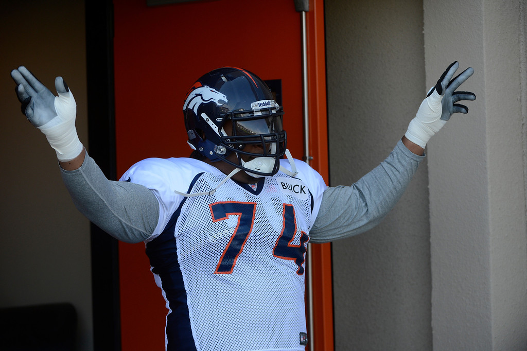 . ENGLEWOOD, CO - JULY 27: Denver Broncos tackle, Orlando Franklin, has a laugh with the media as he comes out of the locker room at the start of training camp at Dove Valley Saturday July 26, 2013.  (Photo By Andy Cross/The Denver Post)