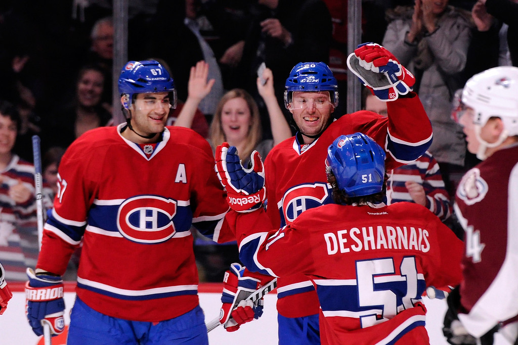 . MONTREAL, QC - MARCH 18:  Thomas Vanek #20 of the Montreal Canadiens celebrates his second-period goal with teammates during the NHL game against the Colorado Avalanche at the Bell Centre on March 18, 2014 in Montreal, Quebec, Canada.  (Photo by Richard Wolowicz/Getty Images)