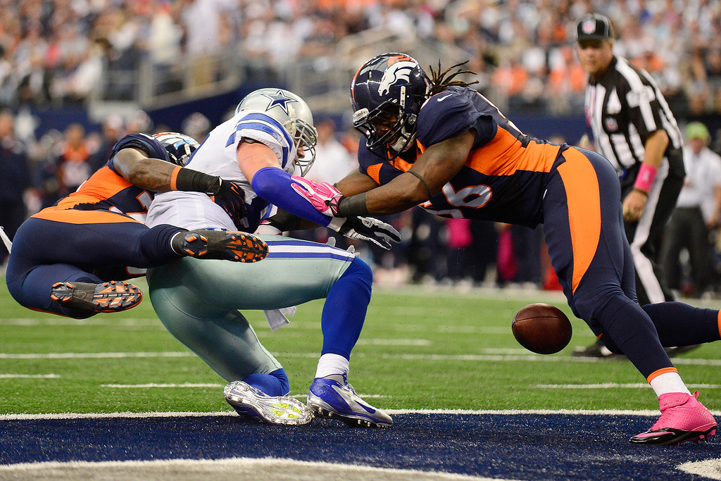 . Duke Ihenacho (33) and Nate Irving (56) of the Denver Broncos break up a pass intended for Jason Witten (82) of the Dallas Cowboys in the endzone during the first half of action at AT&T Stadium.   (Photo by AAron Ontiveroz/The Denver Post)