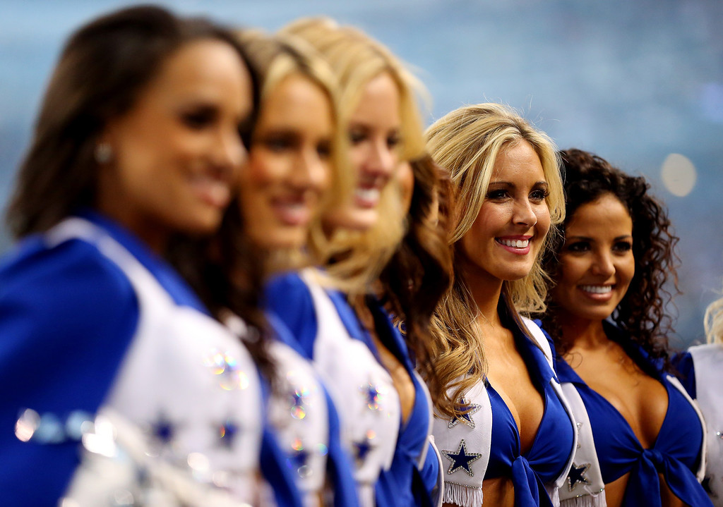 . Dallas Cowboys cheerleaders perform during a game against the Green Bay Packers at AT&T Stadium on December 15, 2013 in Arlington, Texas.  (Photo by Ronald Martinez/Getty Images)