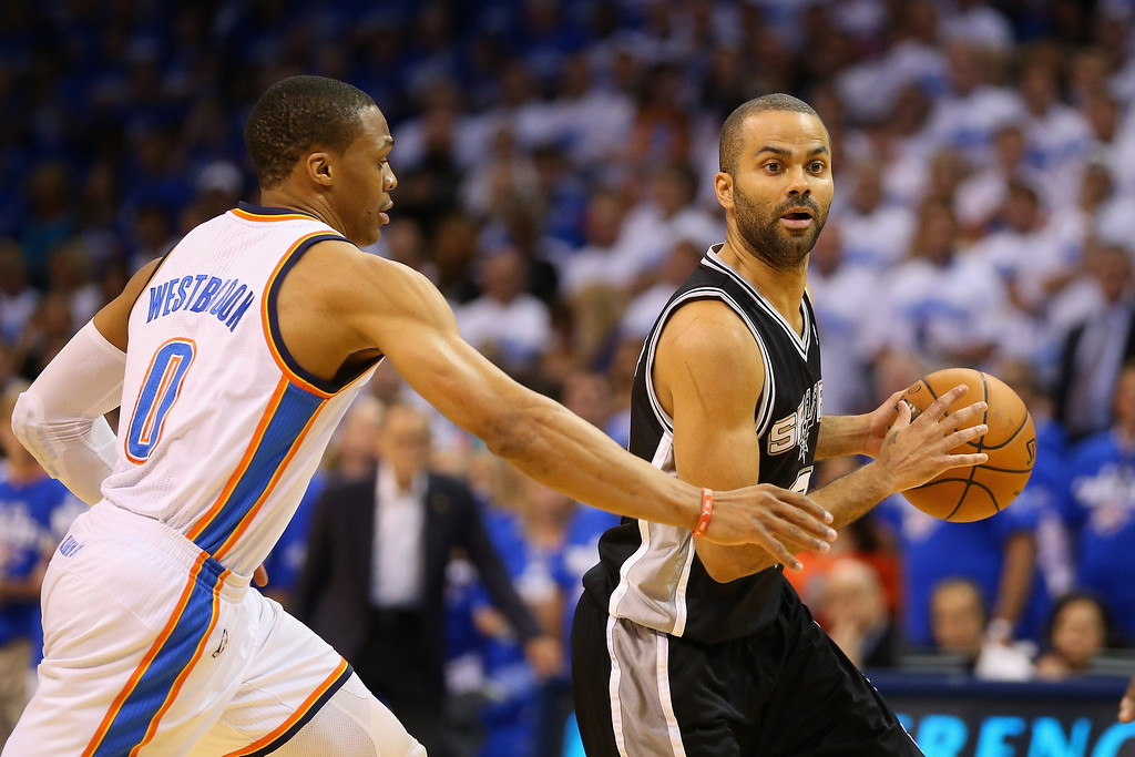 . OKLAHOMA CITY, OK - MAY 27: Tony Parker #9 of the San Antonio Spurs handles the ball against Russell Westbrook #0 of the Oklahoma City Thunder in the first quarter during Game Four of the Western Conference Finals of the 2014 NBA Playoffs at Chesapeake Energy Arena on May 27, 2014 in Oklahoma City, Oklahoma. NOTE TO USER: User expressly acknowledges and agrees that, by downloading and or using this photograph, User is consenting to the terms and conditions of the Getty Images License Agreement. (Photo by Ronald Martinez/Getty Images)