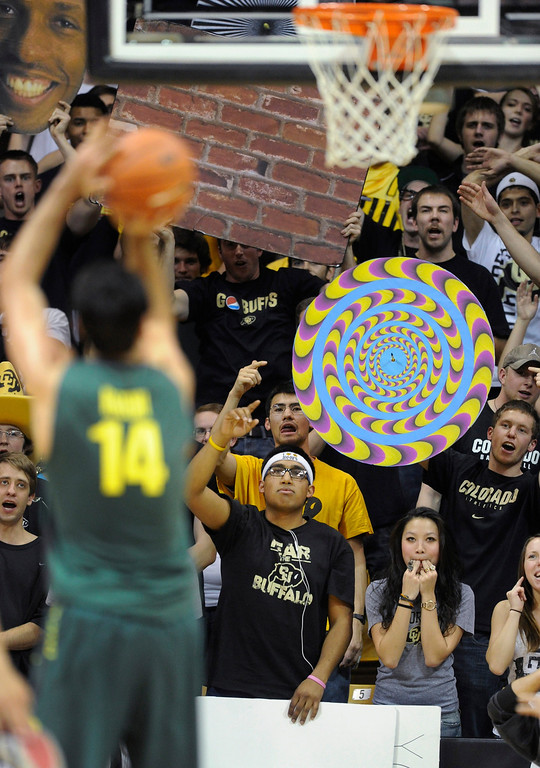 . BOULDER, CO. - MARCH 7: Buffs fans did their best to distract Oregon senior Arsalan Kazemi at the foul line in the second half. The University of Colorado men\'s basketball team defeated Oregon 76-53 Thursday night, March 7, 2013 at the CU Events Center in Boulder. (Photo By Karl Gehring/The Denver Post)