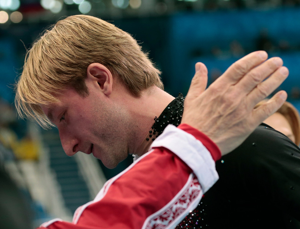 . Evgeni Plushenko of Russia leaves after pulling out of the men\'s short program figure skating competition due to illness at the Iceberg Skating Palace during the 2014 Winter Olympics, Thursday, Feb. 13, 2014, in Sochi, Russia. (AP Photo/Ivan Sekretarev)