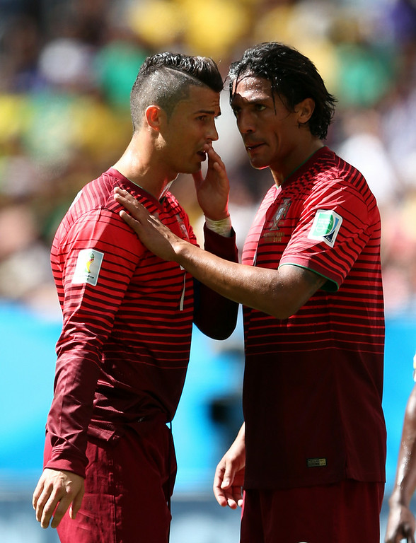 . Cristiano Ronaldo and Bruno Alves of Portugal speak  during the 2014 FIFA World Cup Brazil Group G match between Portugal and Ghana at Estadio Nacional on June 26, 2014 in Brasilia, Brazil.  (Photo by Warren Little/Getty Images)