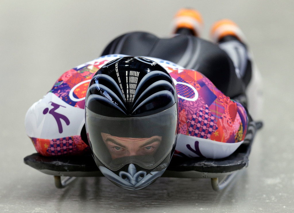 . Ben Sandford of New Zealand starts his first run during the men\'s skeleton competition at the 2014 Winter Olympics, Friday, Feb. 14, 2014, in Krasnaya Polyana, Russia. (AP Photo/Natacha Pisarenko)
