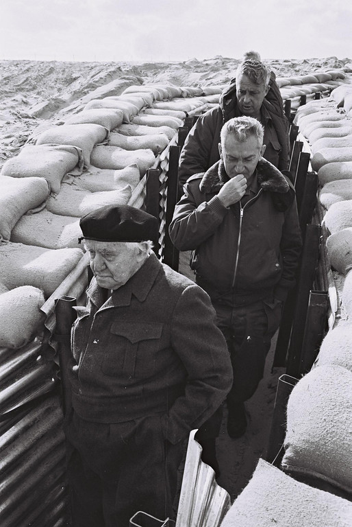 . This handout picture from the Israeli government press office\'s (GPO) archives dated 27 October 1971 shows former PM David Ben Gurion (front), C.O.S Haim Bar Lev (C) and Aluf Ariel Sharon (top) visiting the Israeli Army posts along the Egyptian border, near the Suez canal.      AFP PHOTO/HO/GPO-/AFP/Getty Images