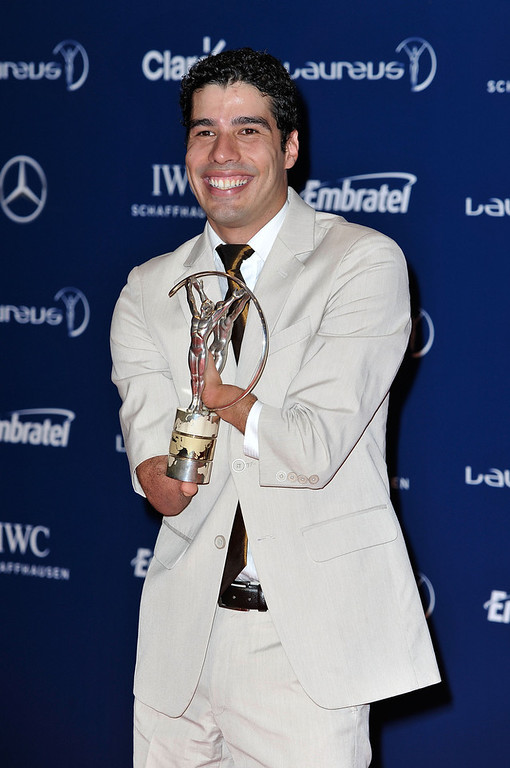 . Daniel Dias with his award for the \'Laureus World Sportsperson of the Year with a Disablity\' at the Winners Press Conferences & Photocall at the Theatro Municipal Do Rio de Janeiro during the 2013 Laureus World Sports Awards on March 11, 2013 in Rio de Janeiro, Brazil.  (Photo by Gareth Cattermole/Getty Images For Laureus)