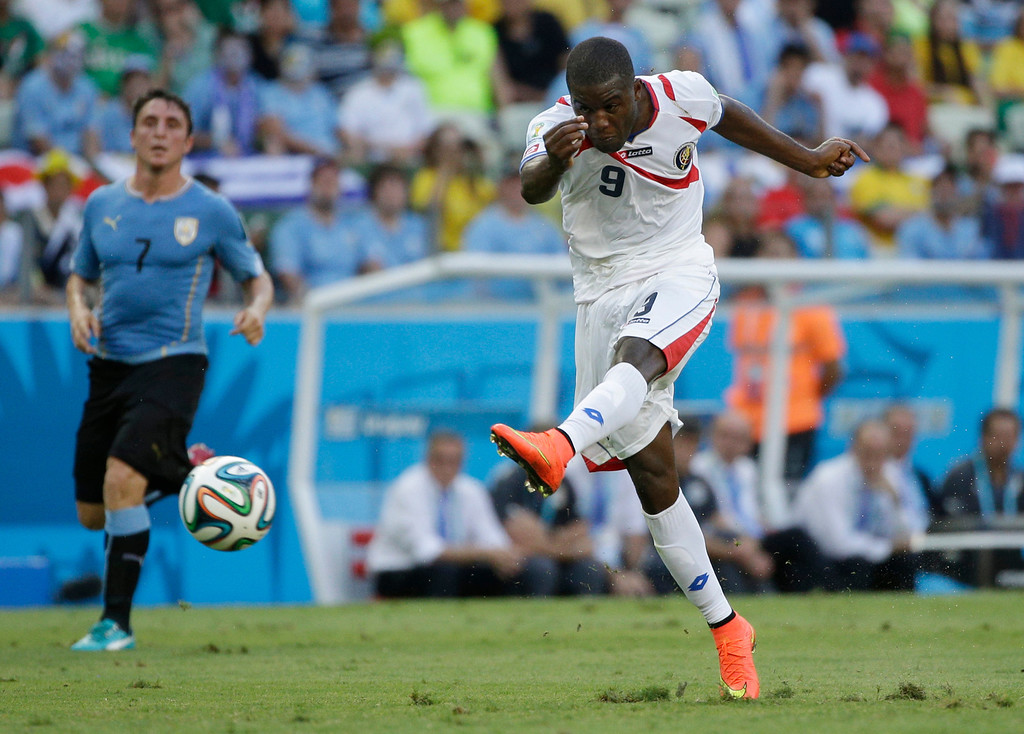 . Costa Rica\'s Joel Campbell has a shot on goal during the group D World Cup soccer match between Uruguay and Costa Rica at the Arena Castelao in Fortaleza, Brazil, Saturday, June 14, 2014.(AP Photo/Christophe Ena)