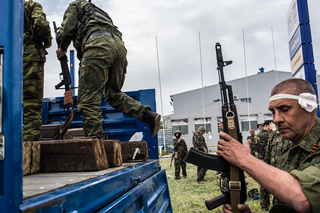 . Members of the pro-Russia Vostok Battalion assemble along the side of the road following early morning clashes with pro-Ukraine fighters on May 23, 2014 in Pisky, Ukraine. At least eight people between the two sides, including one civilian, were killed in an early morning firefight when the Donbass Battalion, a pro-Ukraine militia, attacked a Vostok Battalion checkpoint in the nearby town of Karlivka. (Photo by Brendan Hoffman/Getty Images)