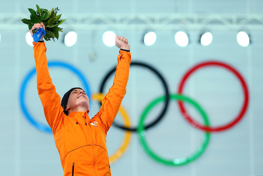 . Gold medalist Irene Wust of the Netherlands celebrates on the podium during the flower ceremony for the Women\'s 3000m Speed Skating event during day 2 of the Sochi 2014 Winter Olympics at Adler Arena Skating Center on February 9, 2014 in Sochi, Russia.  (Photo by Quinn Rooney/Getty Images)