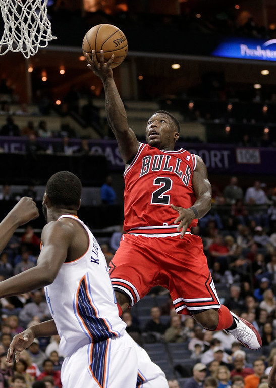 . Chicago Bulls\' Nate Robinson (2) drives to the basket against Charlotte Bobcats\' Michael Kidd-Gilchrist during the second half of an NBA basketball game in Charlotte, N.C., Friday, Feb. 22, 2013. The Bulls won 105-75. (AP Photo/Chuck Burton)