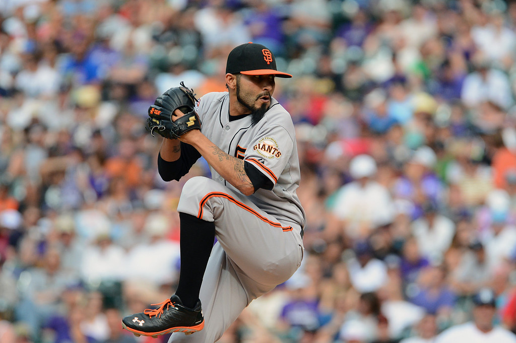 . Sergio Romo #54 of the San Francisco Giants pitches against the Colorado Rockies during the game at Coors Field on June 30, 2013 in Denver, Colorado.  (Photo by Garrett W. Ellwood/Getty Images)