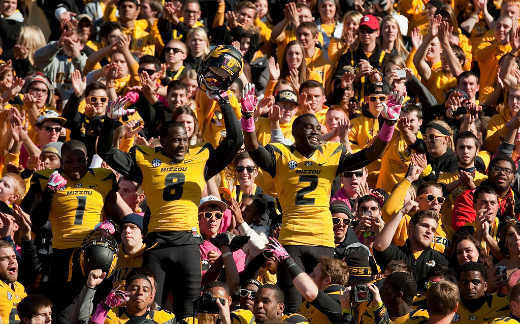 . Missouri\'s L\'Damian Washington, right, Darius White, center, and John Gibson, left, celebrate with fans after they defeated Florida 36-17 in an NCAA college football game Saturday, Oct. 19, 2013, in Columbia, Mo. (AP Photo/L.G. Patterson)