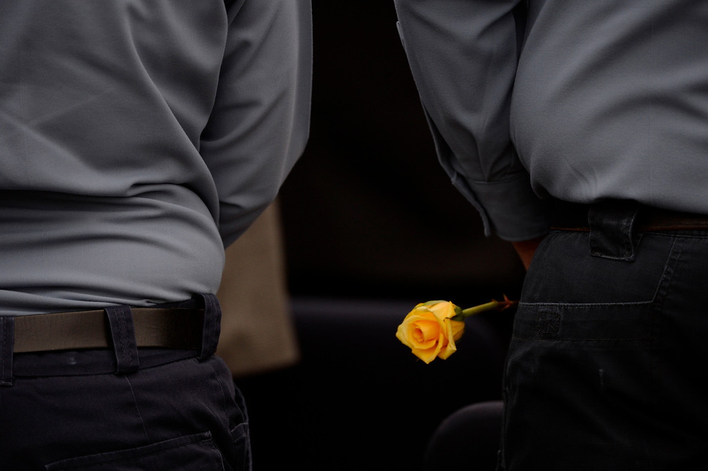 . Sixteen yellow roses were placed in a vase set atop a marble slab, all to honor fallen Department of Corrections officers and officials including, fallen executive director, Tom Clements during the Colorado Department of Corrections Fallen Officer Memorial  at the Territorial Correctional Facility park Saturday morning, March 15, 2014.   (Photo By Andy Cross / The Denver Post)