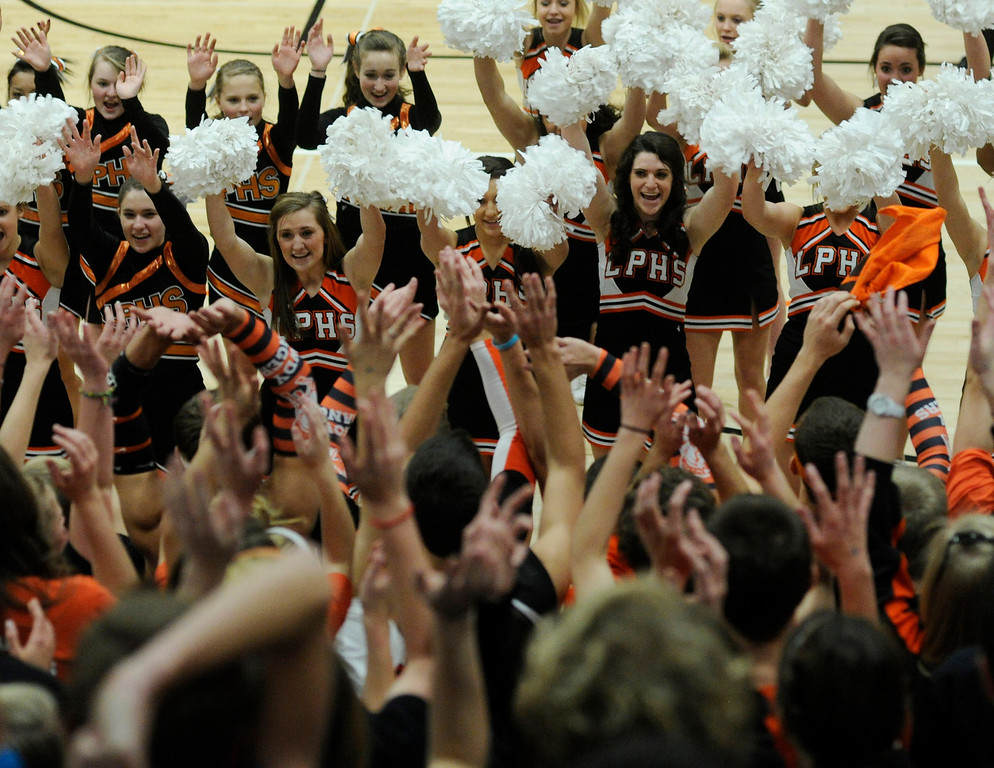 . Cheerleaders pumped up the Rangers student section in the second half Friday night. The Lewis-Palmer High School boy\'s basketball team defeated Broomfield 75-53 Friday night, December 7, 2012.  Karl Gehring/The Denver Post