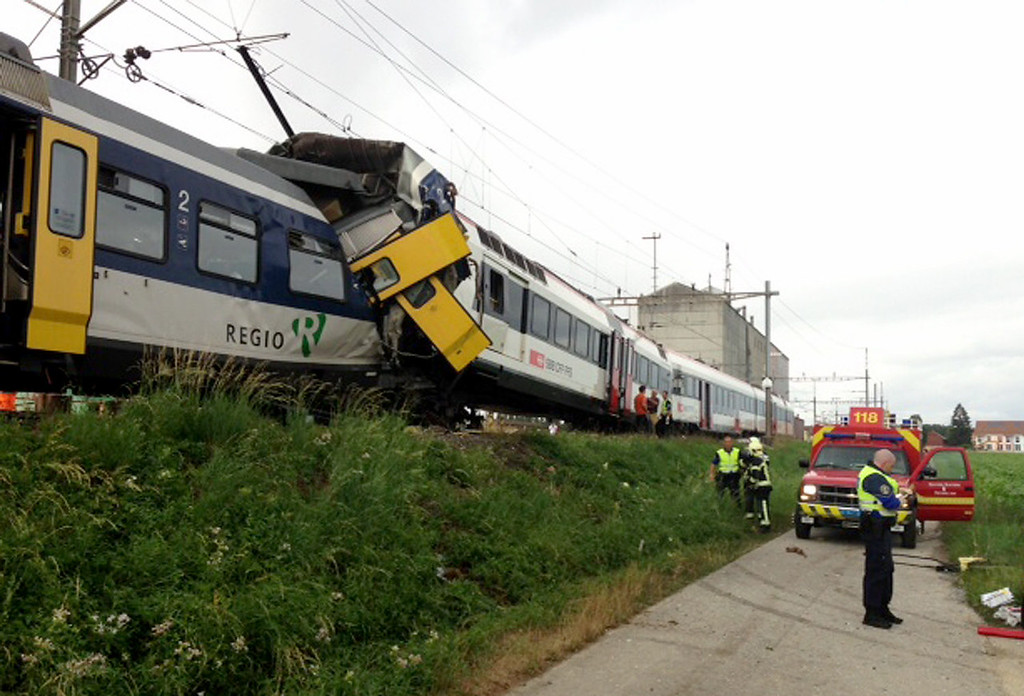 . A collision of two trains on July 29, 2013 in Granges-pres-Marnand, Western Switzerland. Two trains collided head-on, injuring 40 passengers, at least five of them seriously, police said.  AFP PHOTO TDG/24 HEURESHO/AFP/Getty Images