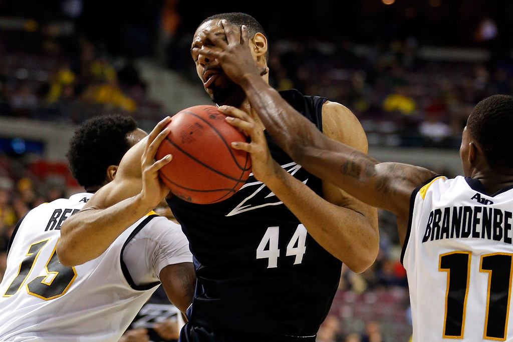 . AUBURN HILLS, MI - MARCH 21:  Zeke Marshall #44 of the Akron Zips takes a finger to the eye from Rob Brandenberg #11 of the Virginia Commonwealth Rams during the second round of the 2013 NCAA Men\'s Basketball Tournament at at The Palace of Auburn Hills on March 21, 2013 in Auburn Hills, Michigan.  (Photo by Gregory Shamus/Getty Images)