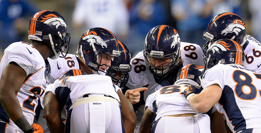 . Denver Broncos quarterback Peyton Manning (18) points in the huddle agains the Indianapolis Colts during the first quarter October 20, 2013 at Lucas Oil Field. Photo by John Leyba/The Denver Post)