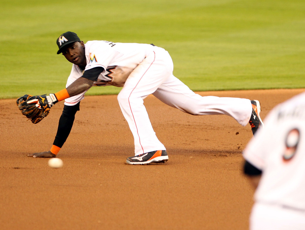 . Shortstop Adeiny Hechavarria #3 of the Miami Marlins dives for a ball against the Colorado rockies during the fourth inning at Marlins Park on April 2, 2014 in Miami, Florida.  (Photo by Marc Serota/Getty Images)