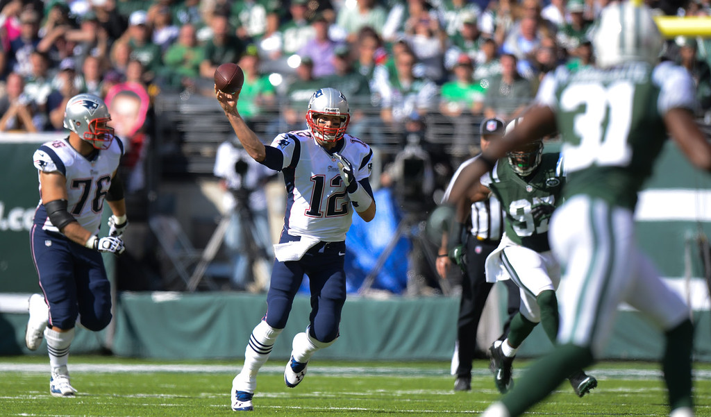 . Quarterback Tom Brady #12 of the New England Patriots throws a pass during the 2nd quarter against the New York Jets at MetLife Stadium on October 20, 2013 in East Rutherford, New Jersey. (Photo by Ron Antonelli/Getty Images)