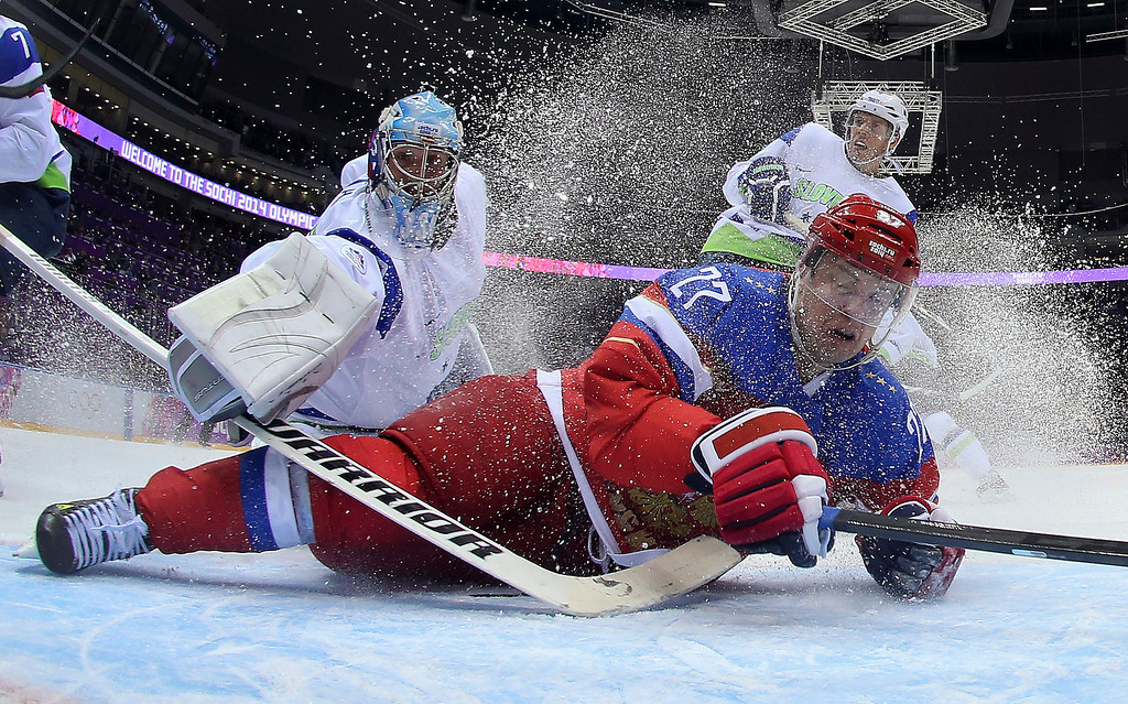 . Slovenia goaltender Robert Kristan reaches over Russia forward Alexei Tereshenko as they fall to the ice at the goal in the first period of a men\'s ice hockey game at the 2014 Winter Olympics, Thursday, Feb. 13, 2014, in Sochi, Russia. Russia won 5-2. (AP Photo/Bruce Bennett, Pool)
