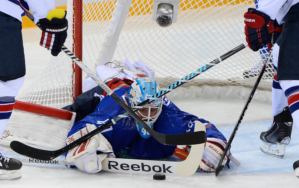 . Slovenia\'s goalkeeper Luka Gracnar covers the puck during the Men\'s Ice Hockey Group A match between Slovenia and USA at the Shayba Arena during the Sochi Winter Olympics on February 16, 2014.   JONATHAN NACKSTRAND/AFP/Getty Images