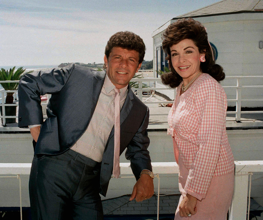 ". Frankie Avalon and Annette Funicello, who starred in ""Beach Blanket Bingo\"",  \""How to Stuff a Wild Bikini\"" and other memorable movies of the mid-Sixties, relax during break in taping of their new movie \""Back to the Beach\"" in Malibu, Calif., April 13, 1987. They play onetime beach lovers who move to Ohio. (AP Photo/Bob Galbraith)"