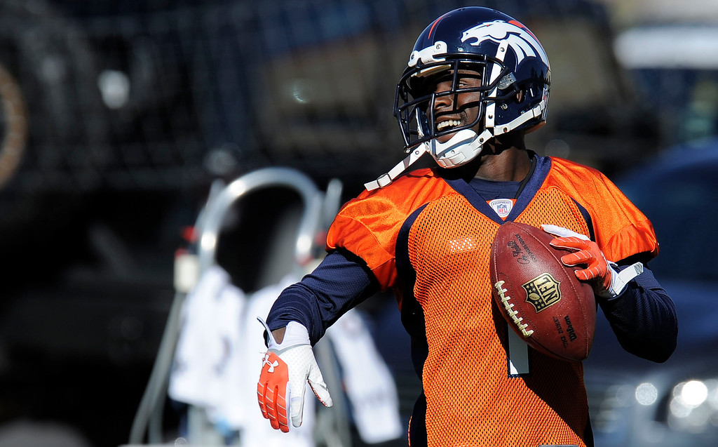 . ENGLEWOOD, CO - OCTOBER 27: Denver Broncos Trindon Holliday (11) smiles after catching a pass during practice on October 30, 2013 at Dove Valley. The players swapped jerseys for Halloween. (Photo by John Leyba/The Denver Post)