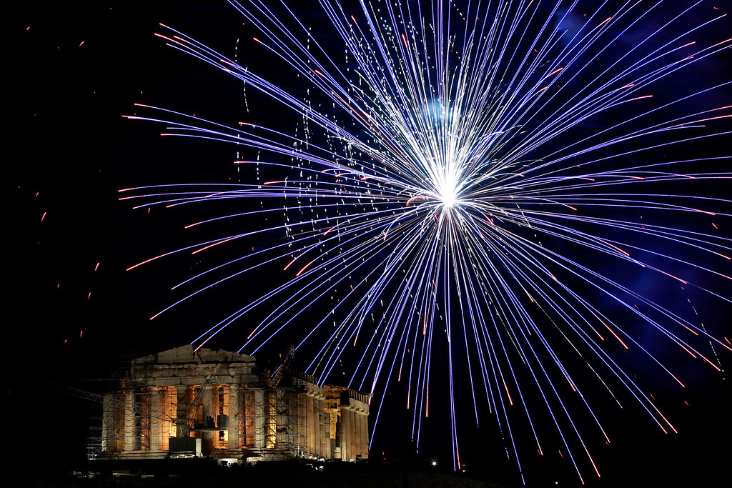 . Fireworks explode over the ancient Parthenon temple at the Acropolis Hill during the New Year\'s celebrations in Athens, on Tuesday Jan. 1, 2013. (AP Photo/Petros Giannakouris)