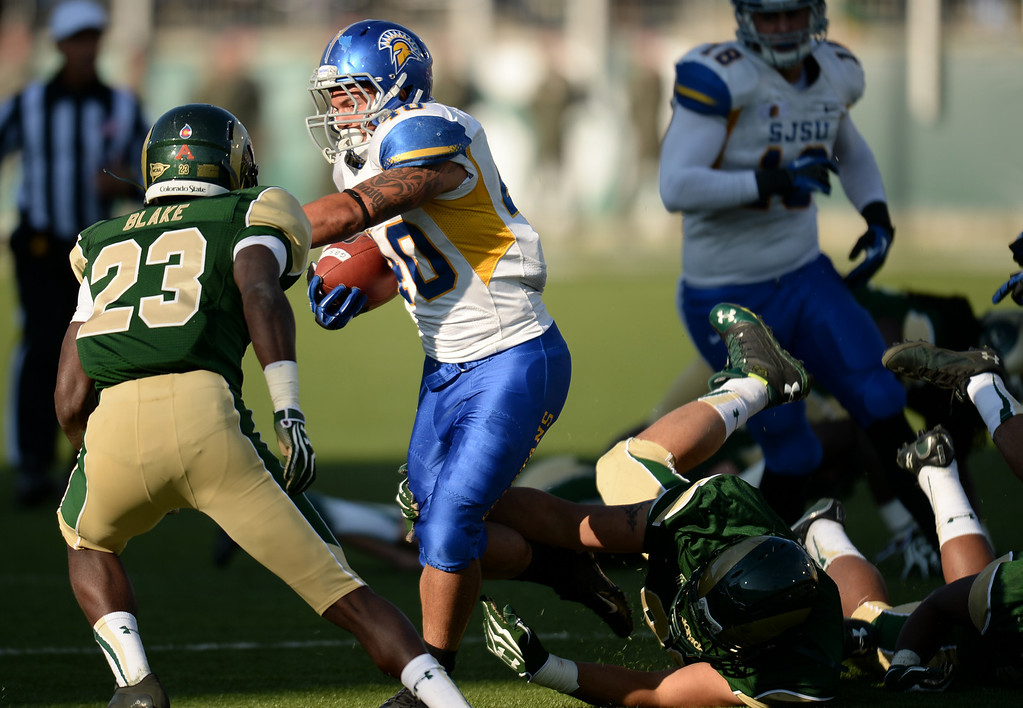. FORT COLLINS, CO - OCTOBER 12 : Jarrod Lawson of San Jose State (40) controls the ball against Bernard Blake of Colorado State (23) in the 3rd quarter of the game at Hughes Stadium. Fort Collins. Colorado. October 12, 2013. San Jose won 34-27. (Photo by Hyoung Chang/The Denver Post)