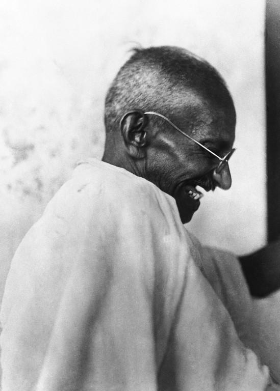 . Mahatma Gandhi laughing around April 23, 1930. (AP Photo)